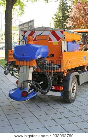 Salt Spreading Attachment At Truck Tailgate For Road Maintenance