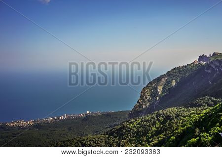 View From Mount Ai-petri On The Sea And The Surrounding Area Of The City Under The Blue Sky.
