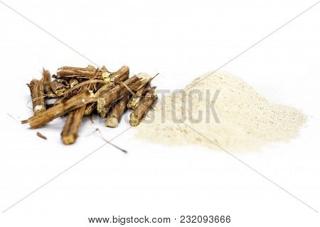 Ashwagandha Roots And Its Powder Also Known As Indian Ginseng, Isolated On White Essential Beneficia