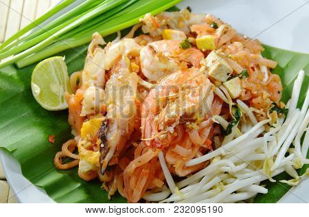 Pad Thai Stir Fried Rice Noodles With Shrimp And Squid On Plate