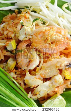 Pad Thai Stir Fried Rice Noodles With Seafood And Egg On Plate
