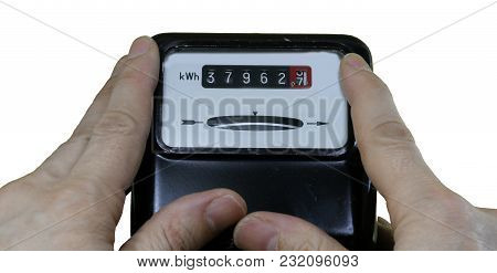 Obsolete Analog Electric Current Meter And Two Hands That Want To Keep It Still