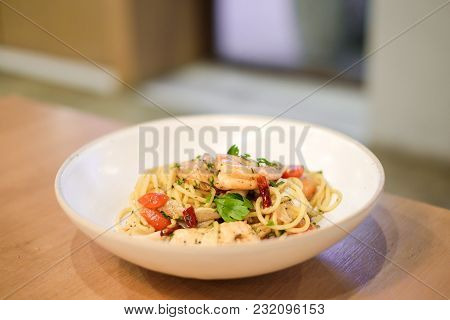 The Spaghetti Spicy Seafood (squid, Shrimp And Salmon) With Basil, Tomato, Black Pepper, Lettuce And