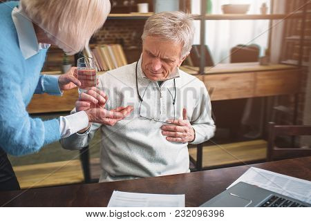 A Picture Of Old Man Keeping His Hand On The Chest Where The Heart Is. His Heart Aches So He Wants T