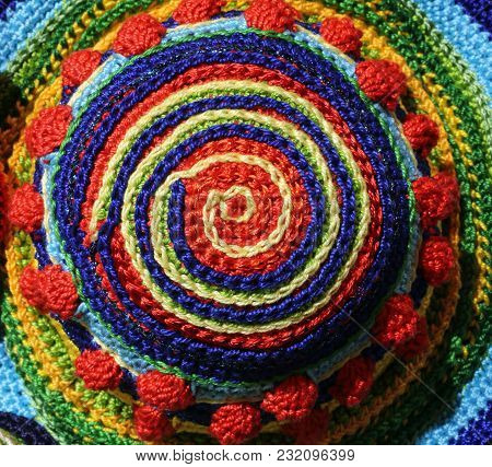 Woolen Threads Woven Together To Form A Colored Spiral