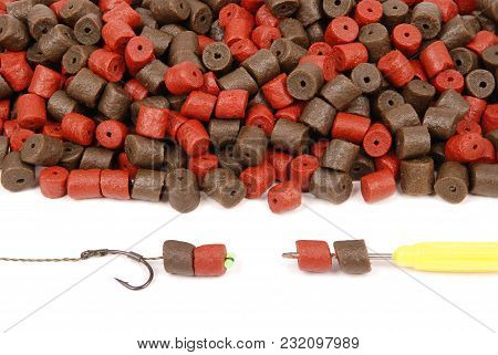 Fishing Bait With Hook And Brown With Red Pre-drilled Halibut Pellets For Carp Fishing Isolated On W