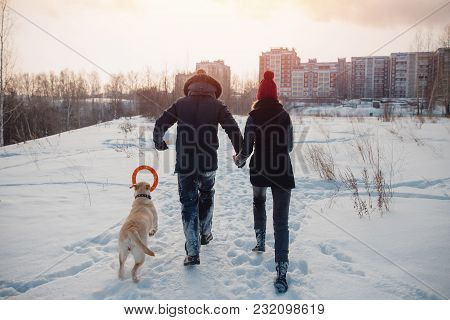 Couple Is Running Home With His Dog. Concept Winter Walk.