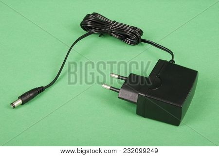 Electric Shaver Charger Isolated On Green Background