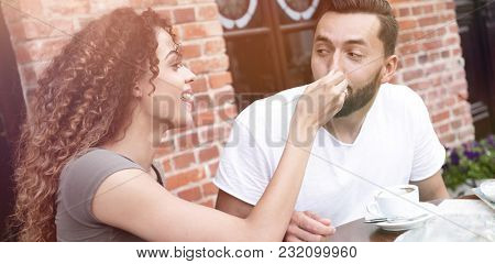 Young tourists eating breakfast at restaurant table outside side