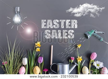 Easter Sales Garden Background With Light Bulb As Sun, Clouds, And Hose Watering Flowers Laid Flat O