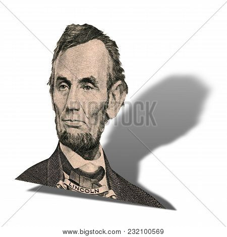 Portrait Of Former U.s. President Abraham Lincoln As He Looks On Five Dollar Bill Obverse. Photo At