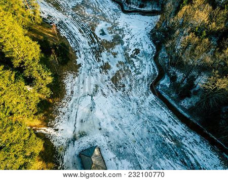 Aerial Photography Of A Bright Forest In Sunny Winter Day From Top