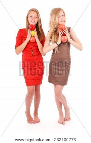 Two Young Girl Holds An Three Apples Isolated On White