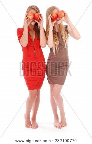 Two Girls Hold Near Eyes Fresh Apples Isolated On White