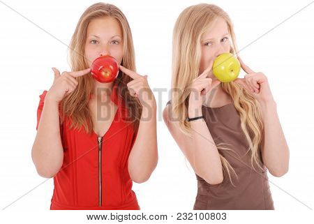 Two Girls Hold In Aples Fresh Cherries Isolated On White