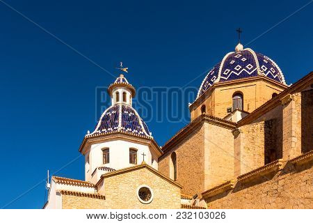 Altea, Spain - March 9, 2018: Dome And Tower Of The Virgin Of The Consol Church In Altea, Spain