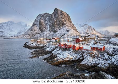 Famous tourist attraction Hamnoy fishing village on Lofoten Islands, Norway with red rorbu houses in winter