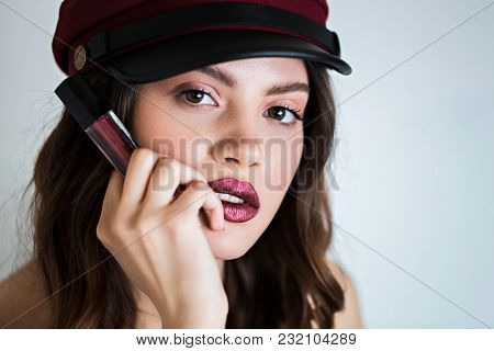 High Fashion. Caucasian Young Glamor Woman With Bright Makeup Looking At The Camera, Holds Her Hand