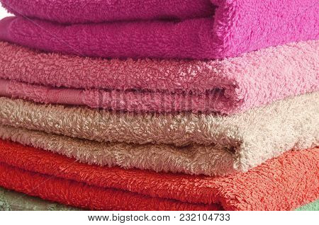 Stack Of Pink And Purple Bathroom Towels Detail