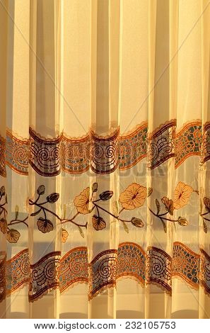 Luxury Draped Golden Decorative Curtain With Flowers Ornamental Indoors At Sunset