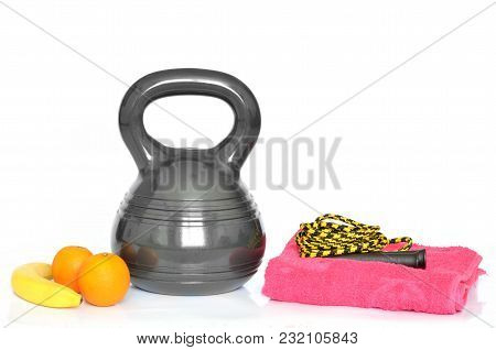 Isolated Modern Design Kettlebell - 10kg, Ab Wheel And Yellow Jumping Rope On White Background