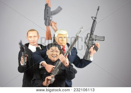 MARCH 16 2018: Caricature of North Korean Supreme Leader Kim Jong Un, US President Donald Trump and Russian President Vladimir Putin brandishing firearms in a gangster style pose.