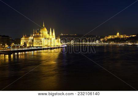 Cityscape Of Budapest At Night. Hungarian Parliament Building, Buda Castle And Chain Bridge Above Da