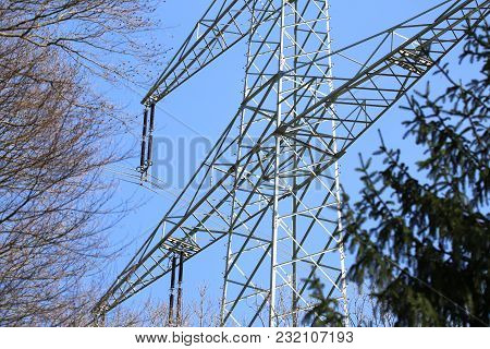 Transmission Line On Background Of Blue Sky