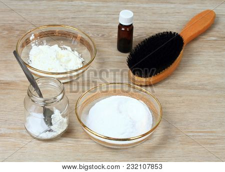 Homemade dry shampoo in a jar made of powder corn starch, baking soda and essential oil for blonde.  DIY cosmetics. Fast and easy way to keep your hair clean. poster