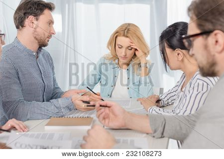 Middle Aged People Signing Contract At Anonymous Group Therapy