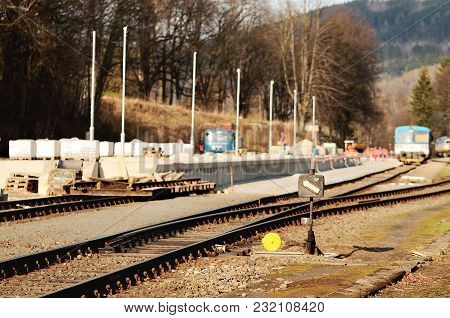 Reconstruction Of The Old Railway Station. New Modern Passenger Platforms. Train And Workers, Labore