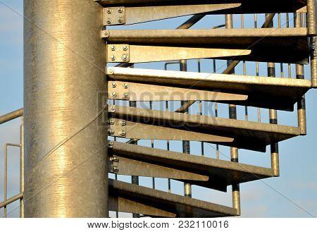 Detail Of Metal Spiral Stairs At Sunset