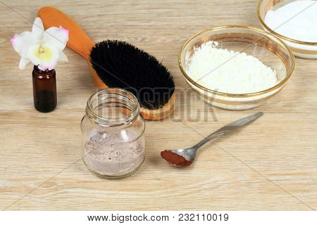 Homemade Dry Shampoo In A Jar Made Of Powder Corn Starch, Baking Soda, Cacao And Essential Oil For B
