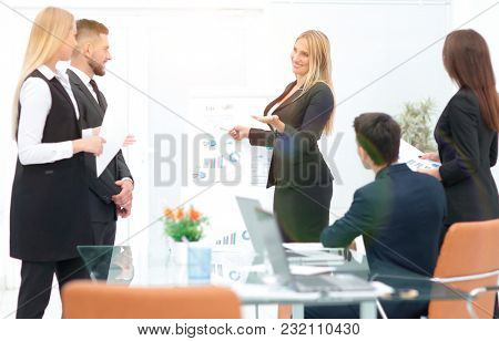 business woman doing a presentation to his business team.