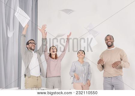 Excited Multiethnic Middle Aged People Throwing Papers