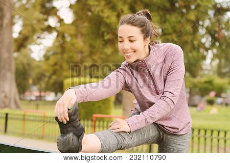 Portrair Of Young Beautiful Woman Doing Exercise At Park. Sport Concept. Outdoors