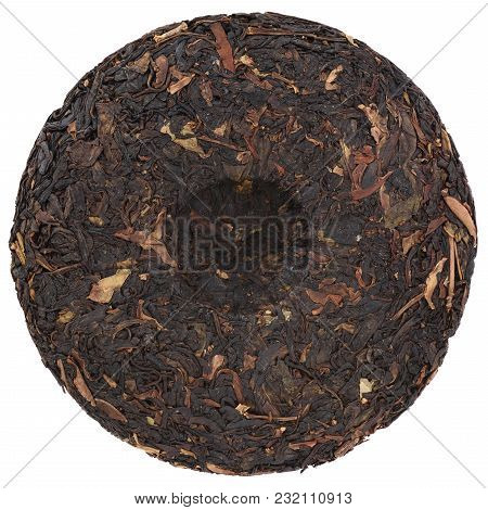 Da Qing Village Wild Purple Pressed Black Tea Round Shape Isolated Overhead View