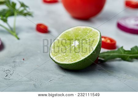 Lime Half On White Vegetable Background, Shallow Depth Of Field. Cloe-up. Juicy Vitamin Ingredient.