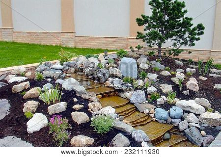 Gorgeous View Of Exterior Of A Private Garden. Landscape Design Called Alpine Slide. Decorative Watt