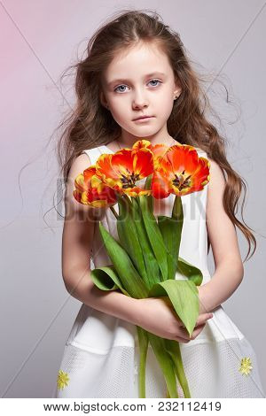 Girl With Big Blue Anime Eyes And A Bouquet Of Tulip Flowers In Her Hands. World Mother's Day, Sprin