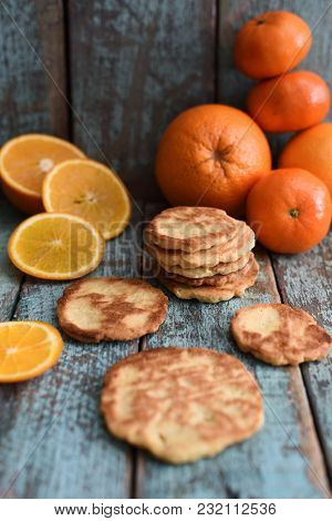 Homemade Vegetarian Orange Cookies With Organic Oranges And Clementines On Shabby Blue Wooden Board