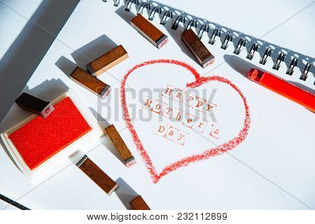 Happy Mother Day Text In Red Heart Written On White Sheet