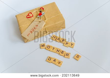 Craft Gift Box For Mother Day On White Background. Happy Mother Day Text Of Wooden Letters