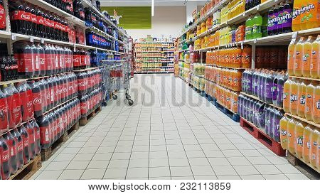 Piatra Neamt, Romania - March 16: Water Bottle In A Store Shelf, Supermarket Aisle In Shopping Cente