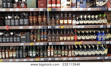 Piatra Neamt, Romania - March 16: Whisky Bottle In A Store Shelf, Supermarket Aisle In Shopping Cent
