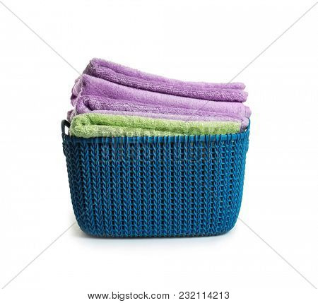 Basket with clean terry towels on white background