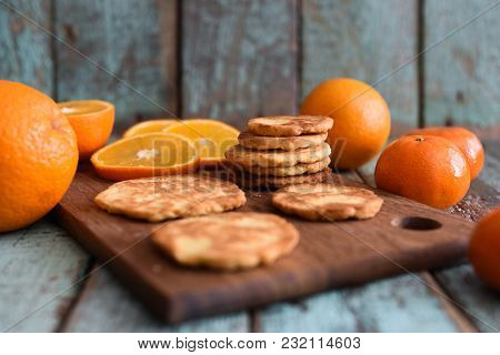 Vegetarian Healthy Sweets. Homemade Tasty Cookies With Raw Oranges And Clementines On Shabby Blue Wo