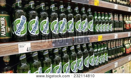Piatra Neamt, Romania - March 16: Beer Bottles In A Store Shelf, Supermarket Aisle In Shopping Cente