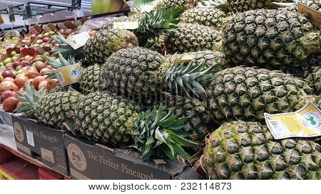 Piatra Neamt, Romania - March 16: Fruits (pineapple)  In Supermarket Aisle  In Shopping Center On Ma