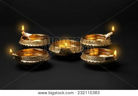 Diwali diyas or clay lamps on dark background
